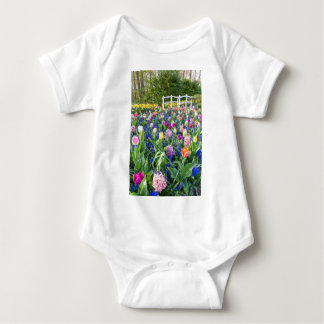 Flowers field with tulips hyacinths and bridge baby bodysuit