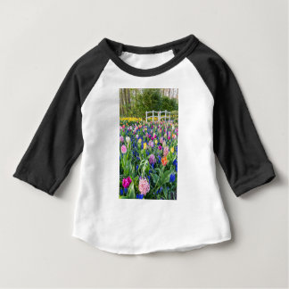 Flowers field with tulips hyacinths and bridge baby T-Shirt