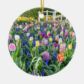 Flowers field with tulips hyacinths and bridge round ceramic ornament