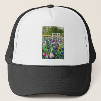 Flowers field with tulips hyacinths and bridge trucker hat