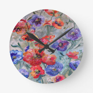 Flowers in a Field of Green Round Clock