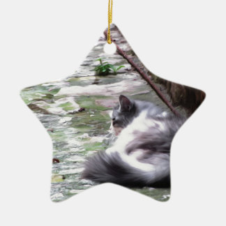 Fluffy cat sleeping crouch on the floor ceramic ornament