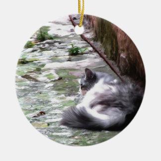 Fluffy cat sleeping crouch on the floor ceramic ornament