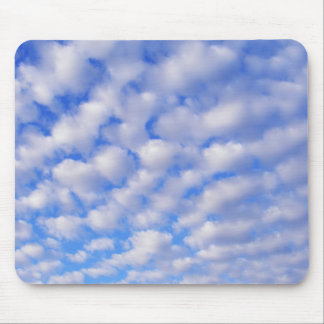 Fluffy clouds and blue skies mouse pad