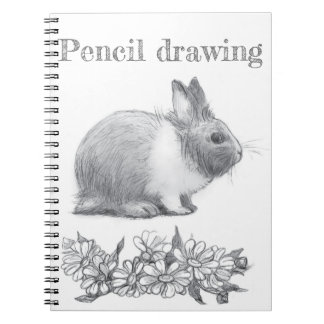 Fluffy the rabbit. Pencil drawing. Notebook
