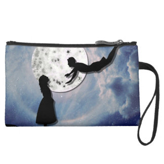 fly me to the moon paper cut universe suede wristlet