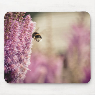 Flying bee pink flowers mouse mat