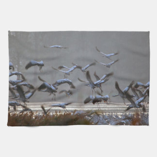 Flying cranes on a lake hand towels