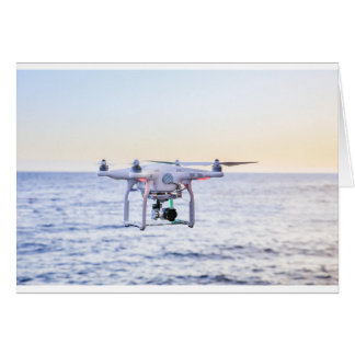 Flying drone at coast above sea card