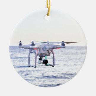 Flying drone at coast above sea ceramic ornament