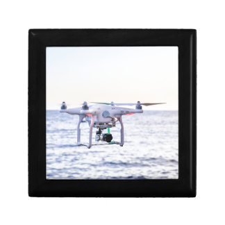 Flying drone at coast above sea gift box