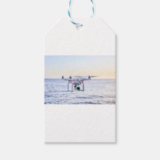 Flying drone at coast above sea gift tags