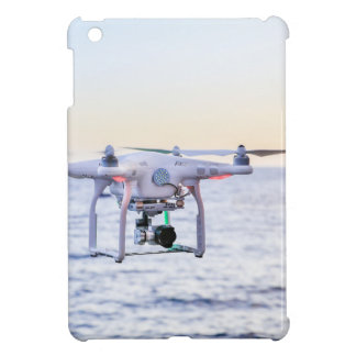 Flying drone at coast above sea iPad mini cases