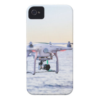Flying drone at coast above sea iPhone 4 cases