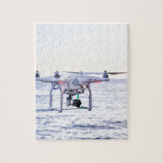 Flying drone at coast above sea jigsaw puzzle
