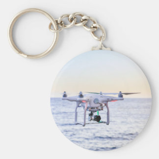Flying drone at coast above sea keychain