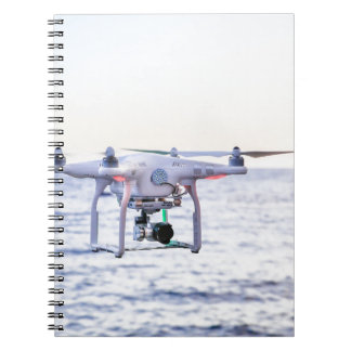 Flying drone at coast above sea notebook