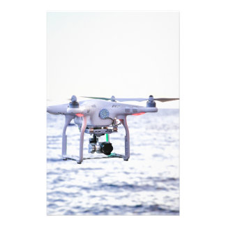 Flying drone at coast above sea stationery
