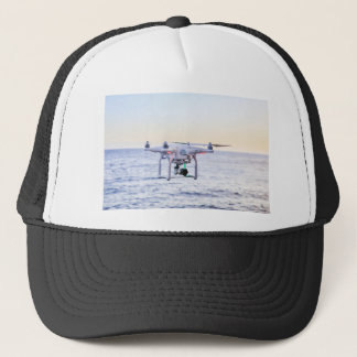 Flying drone at coast above sea trucker hat