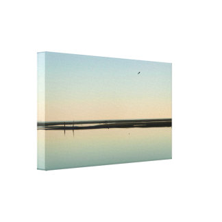 Flying over a low tide beach canvas print