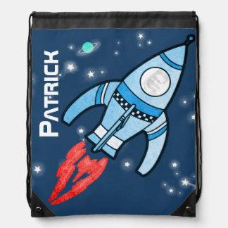 Flying photo rocket kids name blue drawstring bag