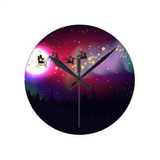 Flying Santa over Aurora Borealis Clocks