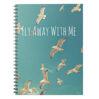 Flying seagulls on the sky vintage notebook