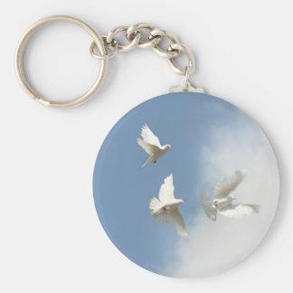 Flying white doves keychain