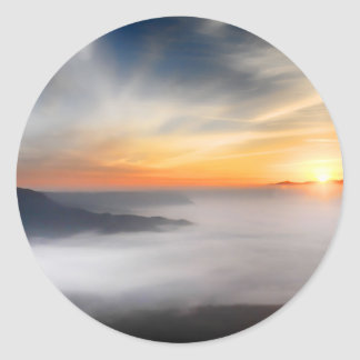 Fog over the mountains of japan during sunrise round sticker