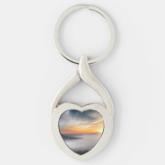 Fog over the mountains of japan during sunrise Silver-Colored twisted heart keychain