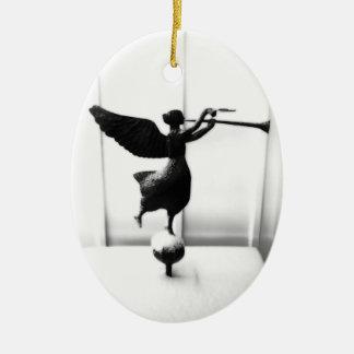 Folk Art Angel in Snow / Ángel Folklórico Ceramic Oval Ornament