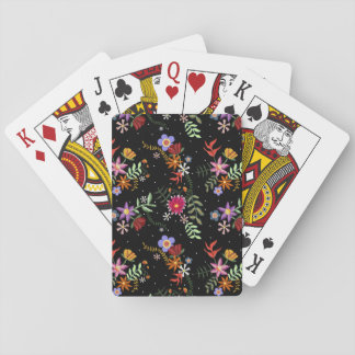 Folk embroidering playing cards