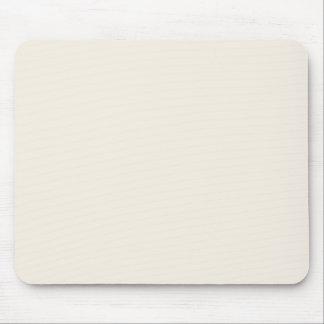 Fond solide beige en ivoire clair de couleur de te tapis de souris