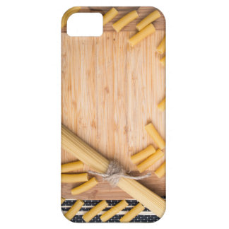 Food background with thin spaghetti and pasta case for the iPhone 5