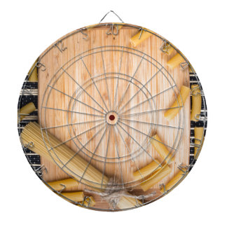 Food background with thin spaghetti and pasta dart board