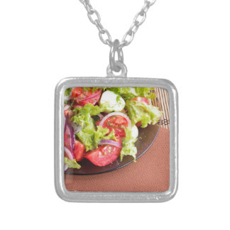Foodstyle background closeup view of a dish silver plated necklace