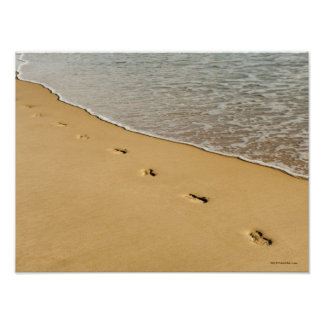 Foot prints in Sand with Wave Poster