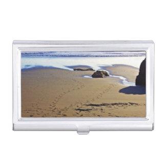 Foot prints on sea coast business card holder