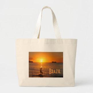 Football at sunset large tote bag