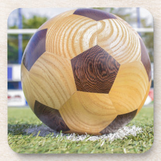 football on penalty spot with goal beverage coasters