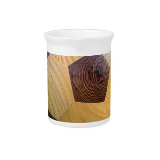 football on penalty spot with goal beverage pitcher