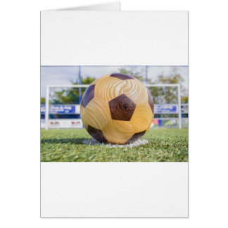 football on penalty spot with goal card