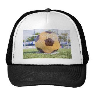 football on penalty spot with goal trucker hat