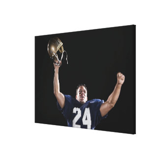 Football player celebrating canvas print