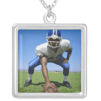 football player playing on a football field silver plated necklace