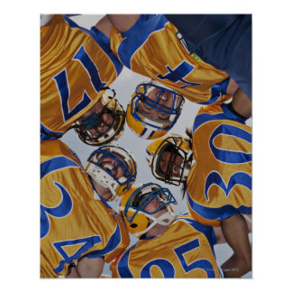 Football players in huddle poster