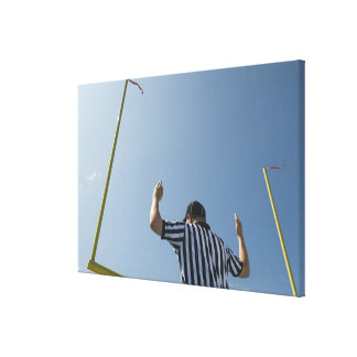 Football referee calling field goal stretched canvas print