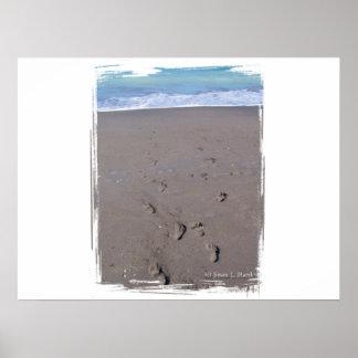 Footprints in beach sand blue ocean in back posters