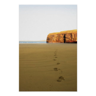 footprints in sand on empty beach on a beautiful w poster