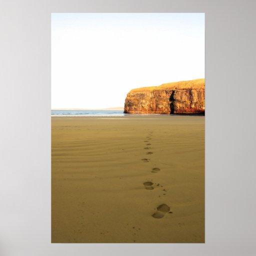 footprints in sand on empty beach on a beautiful w print